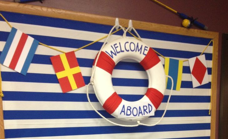 NAUTICAL THEME CLASSROOM photos and ideas...The bold blue and white striped fabric makes an excellent backdrop. Adding letters to a styrofoam life preserver is an easy way to title a bulletin board while adding lots of excitement to a classroom theme on a budget.