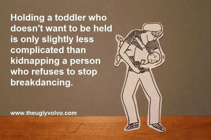 Holding a toddler who doesn't want to be held is only slightly less complicated than kidnapping a person who refuses to stop breakdancing.