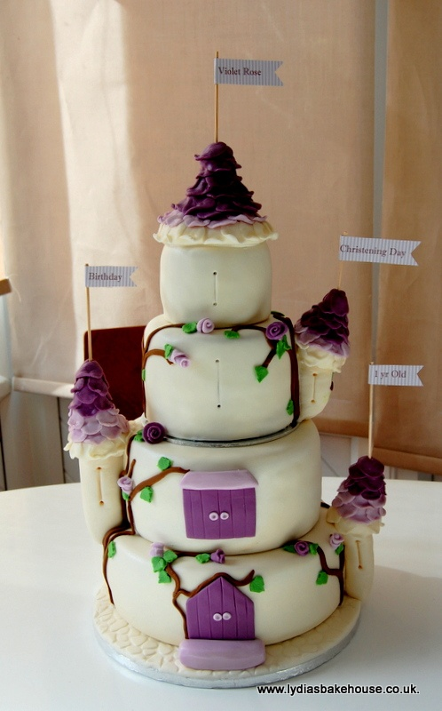 4 tier fairy castle cake for Violet Rose's joint christening & 1st birthday celebrations. available at www.lydiasbakehouse.co.uk. More pictures on Facebook.