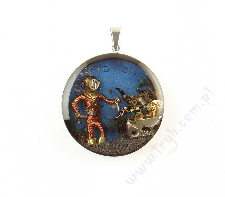 Deep sea diver fighting wit a squid coming out of the treasure chest - handmade pendant.  http://polandhandmade.pl  #‎polandhandmade #deep_sea_diver #diver #squid #treasure #steampunk #pendant #tryb #jewelry