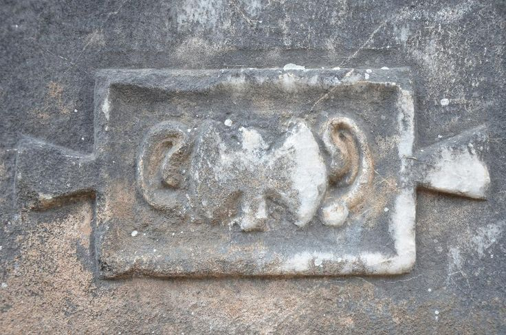 One of the stone walls of the Temple is engraved with a double-headed axe, symbol of Carian Zeus, with a pair of ears