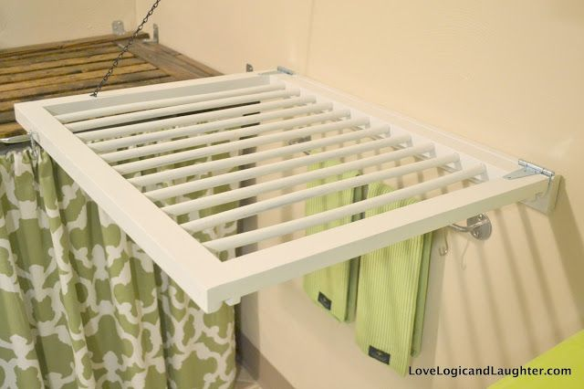 A fold-away wall drying rack made from a baby/dog gate. Spray painted white and repurposed/upcycled as a drying rack!