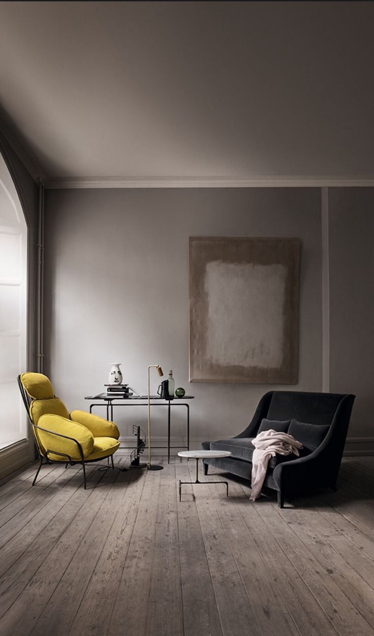 Beautiful moody living room decoration with gray color room, polished floor, yellow and black color sofa chair with beautiful accents