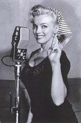 On the air for NBC With crossed fingers and head scarf.     Marilyn Monroe, circa 1953, NBC, radio