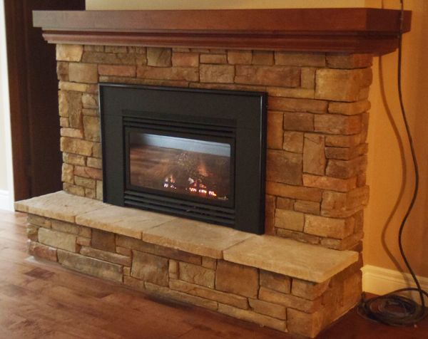 Brick fireplace mantels 17 wood fireplace mantels ideas by like the way the - Brick fireplace surrounds ideas ...