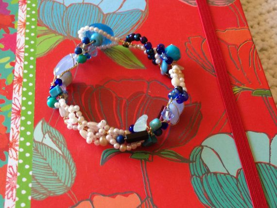 Multi-coloured Blue and Ivory Beaded Gold Wire Wrap Bracelet on Etsy, $9.99 CAD