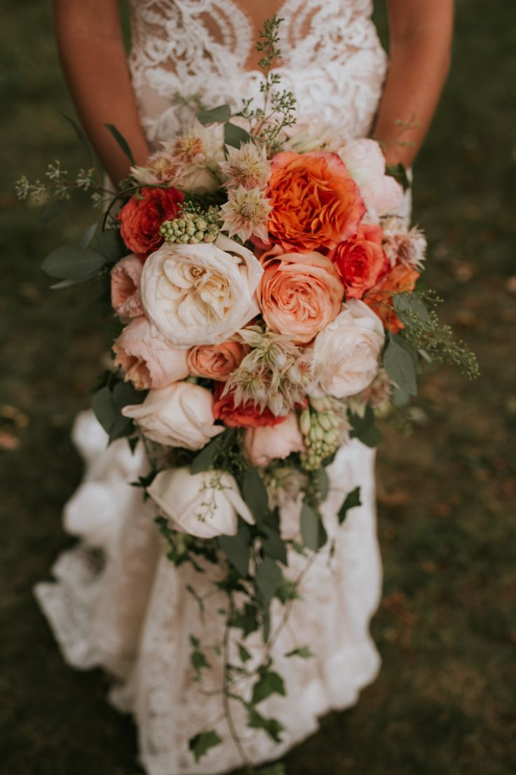 Cascading coral bouquet; PHOTOGRAPHY by Joel + Justyna Bedford;