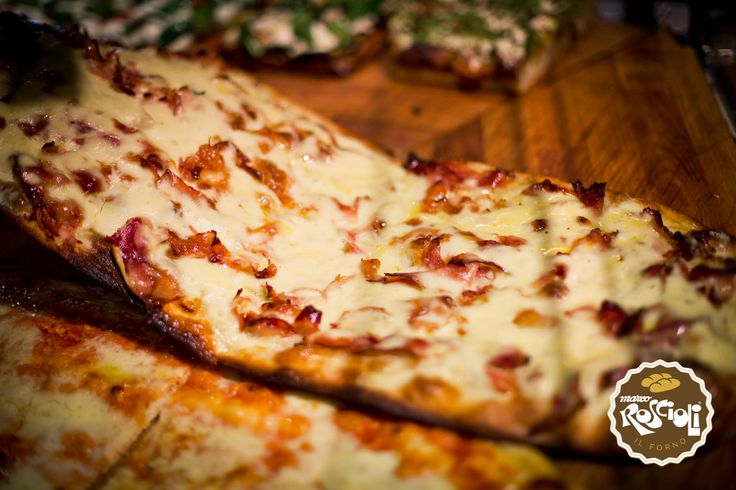 Ham Steack Pizza. It is the red pizza enriched with mozzarella and ham steack