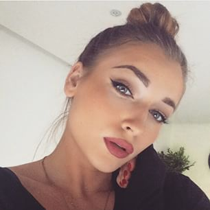 bright highlighted eye and sleek bun. full dusty rose lips with a matte finish.