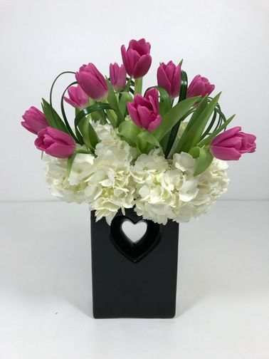Romantic Tulips-The name speaks for itself!   A wonderful ceramic vase available in 3 colors (Black, Red and White)  We have a limited number of these vases so we will begin with the black vase and then use the red and white until they are gone. #ValentinesDay #ValentinesDayFlowers #RomanticFlowers #Tulips #ToblersFlowers #KansasCityFlowers