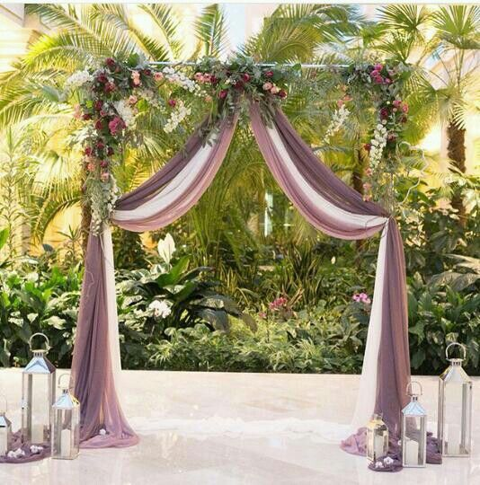 Combine sheer drapery with your floral arbor for romantic ceremony decor