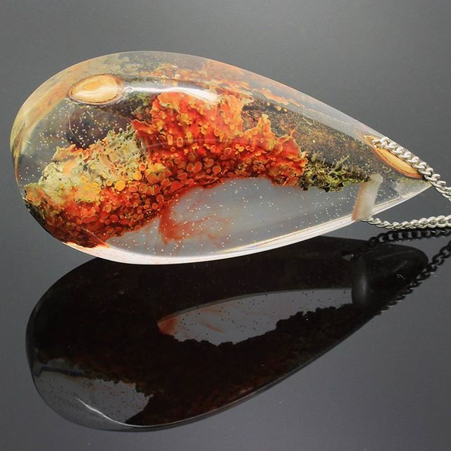 A piece of colorful lichen embedded in crystal clear resin! . . I hope everyone is having a wonderful holiday season! Handmade jewelry by WoodAllGood #WoodAllGood