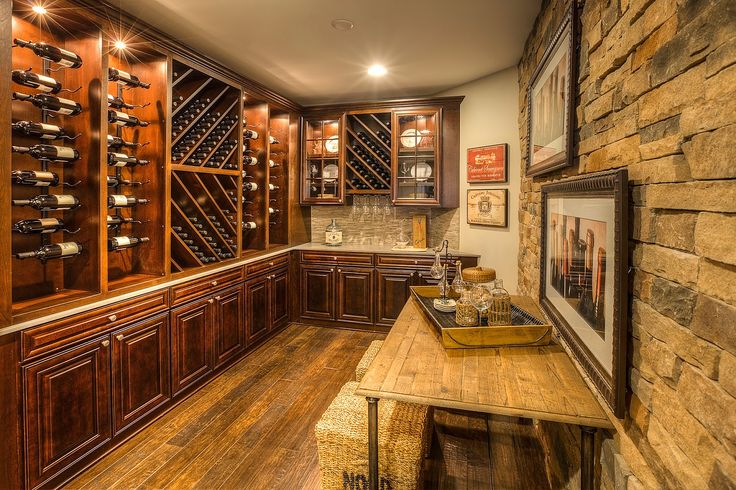 Guildcraft, LLC | Gallery | Wine Cellars & Wet Bars Custom Built-In Wine Cellar and Tasting Room, with Tasting Table, Wine Racks, Glass Door-Enclosed Upper Cabinets, and Base Cabinets. Tuscan/Old World Style with Dark Wood and Stone