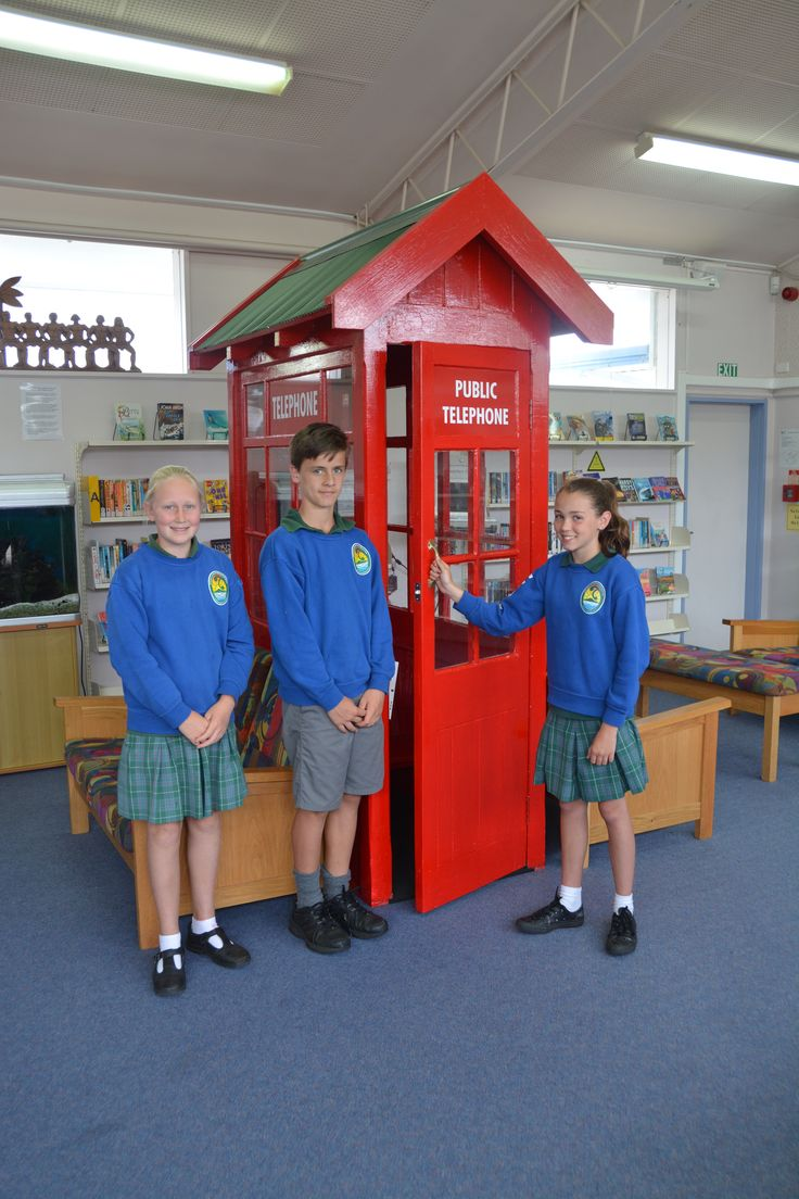 An old red public telephone box has been fitted with a seat and an iPad on a wall mounted arm as a place to listen to audio books. The telephone box was built in 1910 and has been renovated.
