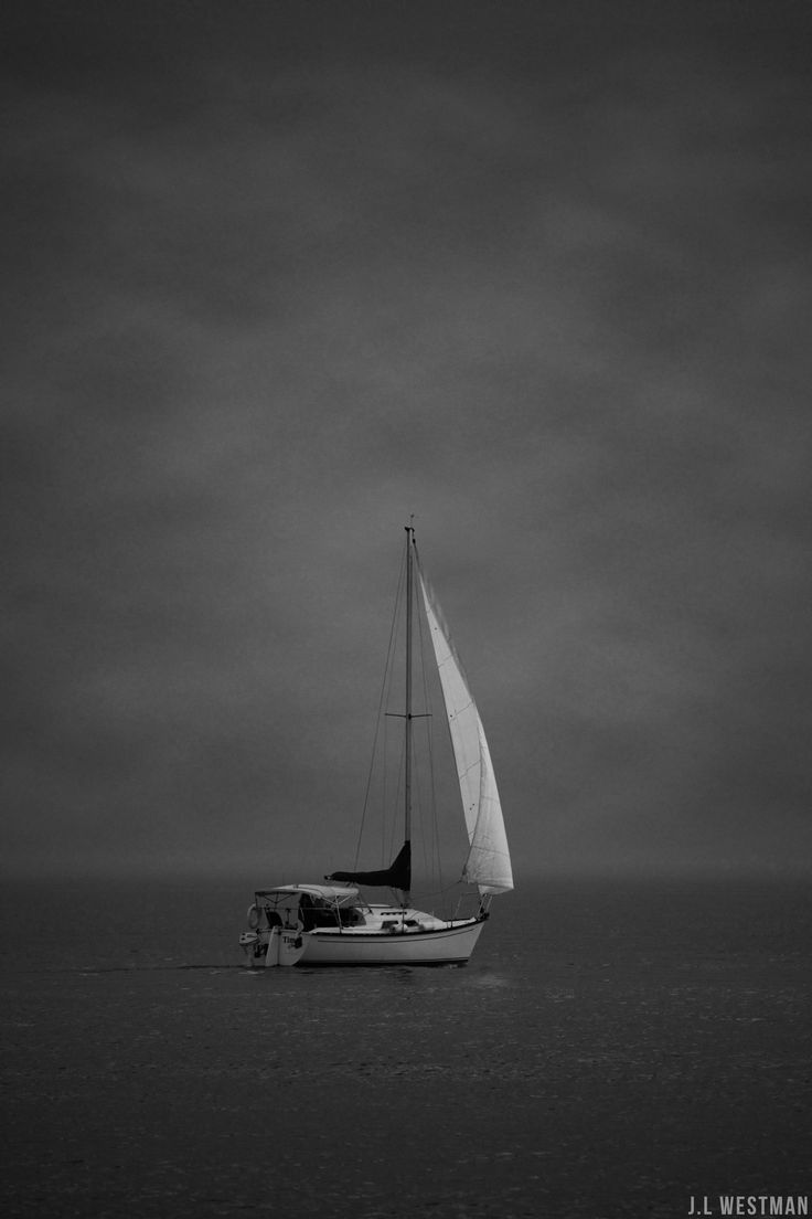 Sail boat in the early morning fog
