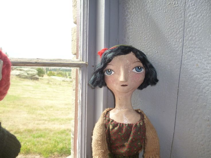 Larger doll with paperclay over cloth features. Crackle gloss applied to give aged appearance. Dyed black mohair used