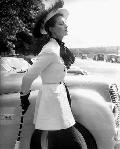 Capucine at the Concours d'élégance automobile, in front of a Delahaye, Bois de Boulogne, June 1951      Photo by Roger Viollet