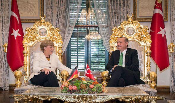 Germany insists trade surplus is narrowing as exports grow amid Merkel's Turkey deal