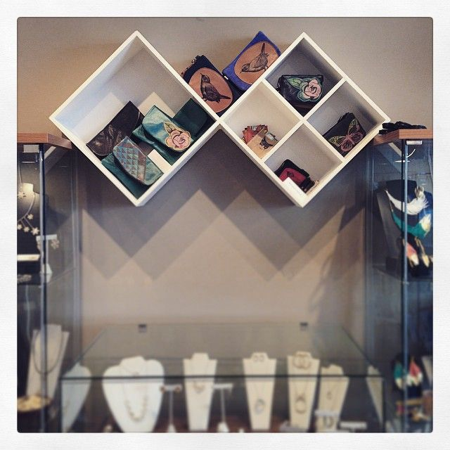 Our new shelves!! They frame @bonspielcreation pretty nicely!! #garnishrevelstoke #bonspielcreation #springhassprung #clutch #madewithloveincanada #shoprevy #canadianhandmade #recycledleather #leather