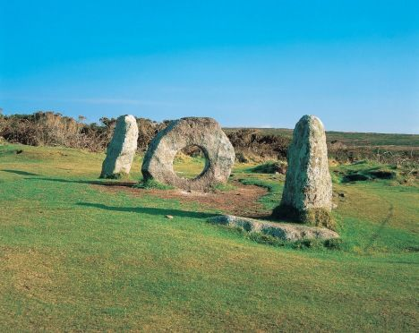 One of the best known megalithic structures in Britain, 'Men-An-Tol' means 'holed stone' and looks like the figures '101' from a certain angle. Its true purpose remains a mystery | St Ives, Cornwall