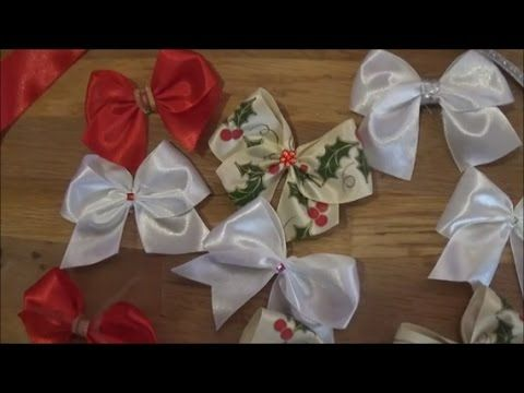 """This video presents how to make bows from 4cm ribbon. Materials: ribbons, thread and needle, several shiny decorative materials and hot glue gun Αυτό το βίντεο παρουσιάζει πως φτιάχνω φιόγκους με κορδέλα 4cm. Υλικά:κορδέλες, βελόνα και κλωστή, διάφορα λαμπερά διακοσμητικά και πιστόλι ζεστής σιλικόνης"""