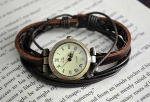 Timepiece Bracelet. I don't wear watches because I don't like to be reminded of how late I'm running, but I LOVE this. I need it.