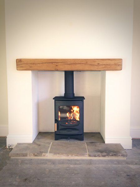 Charnwood C-Four, reclaimed yorkshire stone hearth, oak fireplace beam.jpg