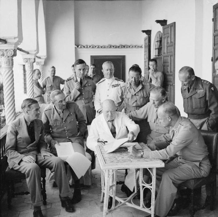 Group photograph of participants in the Allied Planning Conference which took place at the Allied Force Headquarters (AFHQ) in Algiers on 4 June 1943. From left to right: Mr Anthony Eden, General Sir Alan Brooke, Air Chief Marshal Tedder, Admiral Sir Andrew Cunningham, General Alexander, General Marshall (USA), General Eisenhower and General Montgomery. The Prime Minister, Mr Winston Churchill, who presided over the conference, is seen at the center of the group.