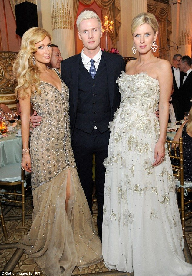 Great genes! The Hilton siblings - (L-R) Paris, Barron Hilton, and Nicky - posed for a stunning snapshot at the star-studded event