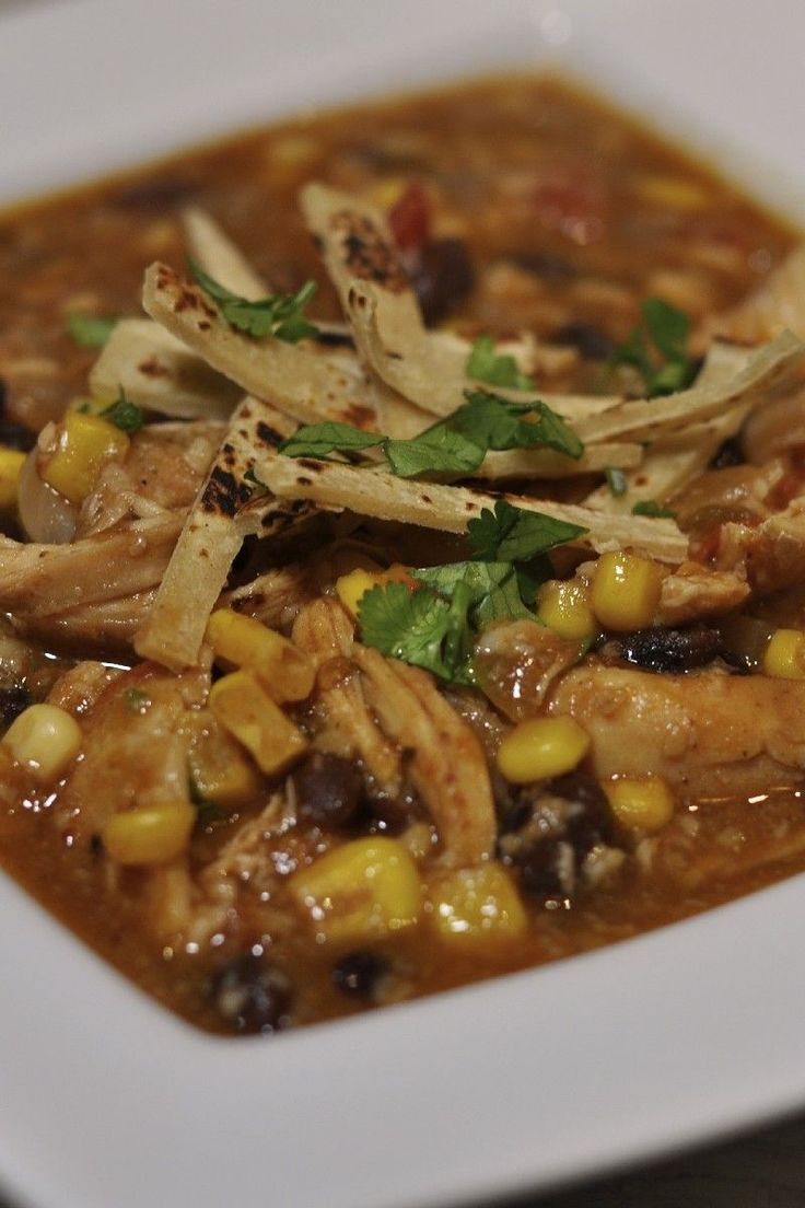 Recipe including course(s): Entrée; and ingredients: beans, beer, boneless, skinless chicken breast, cheddar cheese, corn, green chili pepper, onion, sour cream, taco seasoning mix, tomato sauce, tortilla chips