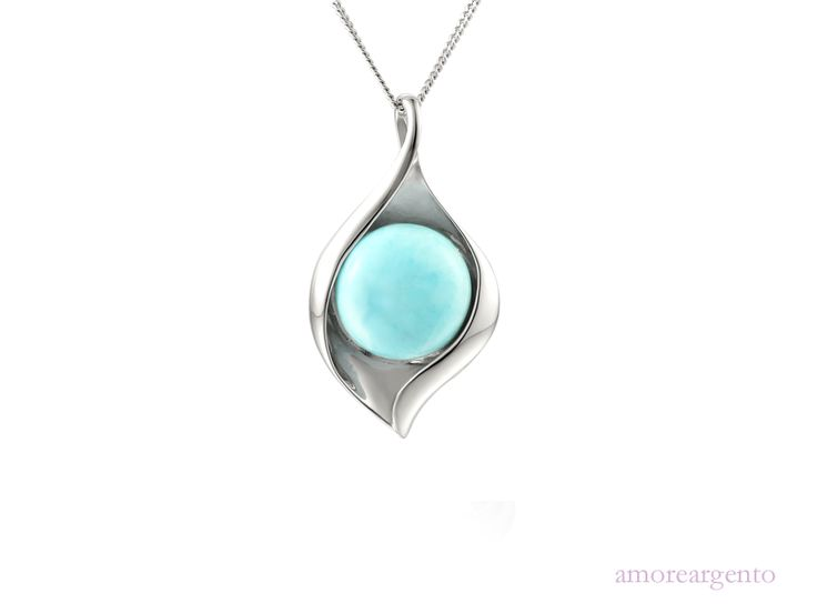 """Blue Ice Necklace - Classic and elegant design enhanced by a striking modern setting swirling around a beautiful larimar stone erupting with vibrant colours. Comes with a 16"""" to 18"""" adjustable silver curb chain. Larimar is a rare blue stone found only in the Dominican Republic. Its colouration varies from white, light-blue, green-blue to deep blue. The contrast of volcanic blue and sterling silver create an elegant radiance that will adorn any outfit - http://goo.gl/h6f8QM"""
