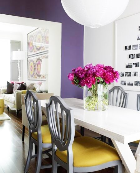 love the black and white photograph installation on the right with the pops of color.