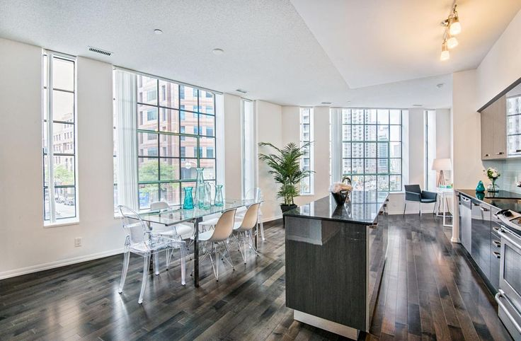 Burano Lofts and Condos - #203 | TorontoLOFTS.ca | Own a piece of history! Rare, one-of-a-kind 1225 sf 2 bedroom + den corner in original part of the building with 7 ft high arched warehouse windows, 9 ft high ceilings and large angled SE window wall. Uber convenient Bay St. locale. | Book a visit here: http://torontolofts.ca/burano-lofts-and-condos-lofts-for-sale/832-bay-st-203 | Contact: info@torontolofts.ca