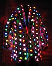 "lights for jackets - Google Search Some people light up the room naturally. Others of us need help. And adding 400 LEDs to what is pretty much the epitome of pimpwear already is the perfect fashion storm to make you the star of this year's office festivities. When first activated, the lights alter colors in sync. But over time, this synchronization wears off and the jacket becomes what firsthand accounts will surely refer to as ""light vomit."""