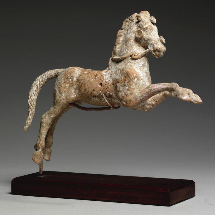 A HELLENISTIC TERRACOTTA HORSE, MAGNA GRAECIA, CIRCA 3RD CENTURY B.C.