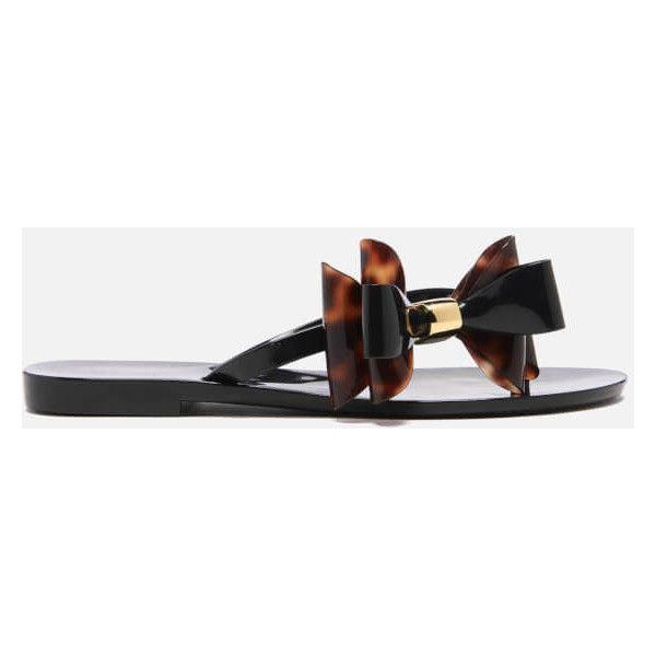Melissa Women's Harmonic Cute Flip Flops - Black Tortoiseshell ($46) ❤ liked on Polyvore featuring shoes, sandals, flip flops, black, black patent sandals, bow thong sandals, thong sandals, black flip flops and black flat shoes