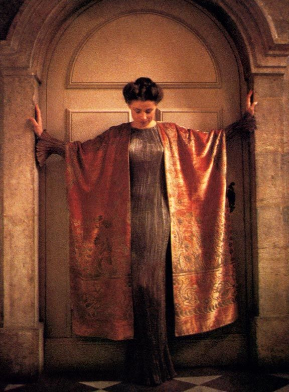 Colette Alliot-Lugaz in a Fortuny Delphos and velvet mantle stenciled in silver and gold, with a motif inspired by Cretan art