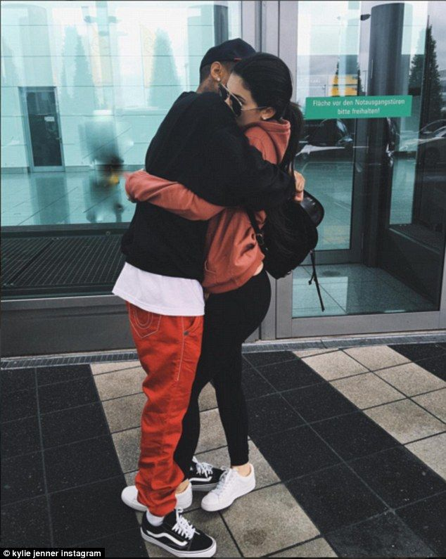'Bye bye': On Thursday Kylie left her beau in Germany to return to LA, sharing a snap of the duo hugging at the airport