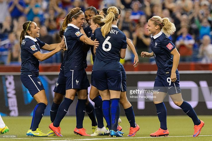 Marie Laure Delie #18 of France celebrates her goal with teammates during the 2015 FIFA Women's World Cup Round of 16 match against Korea Republic at Olympic Stadium on June 21, 2015 in Montreal, Quebec, Canada.