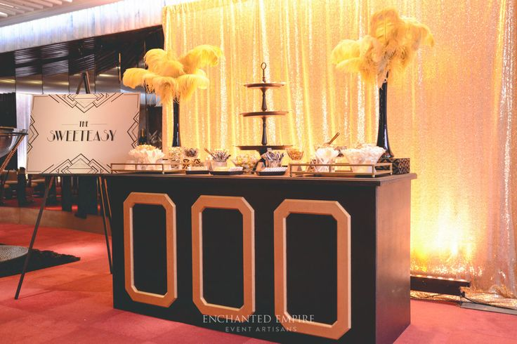 This lavish and extravagant Gatsby Gala Affair was to celebrate Protech's 10 year anniversary. With custom built Art Deco props from our fabrication department, there was a bold palette of black and gold, custom gold foliage fanned out across the room to capture the true essence of the Great Gatsby theme with our custom built champagne tower. You Tube: https://youtu.be/MZCsICuImJA