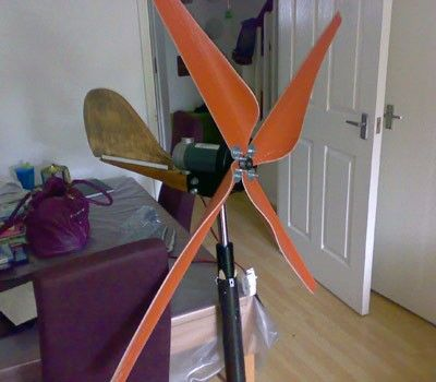 Wind Turbine by Super windy -- Homemade wind turbine constructed from a surplus treadmill motor, PVC, and an aluminum frying pan. http://www.homemadetools.net/homemade-wind-turbine-8
