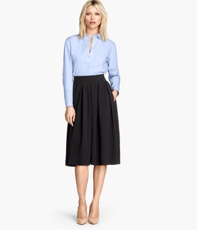 blue button-up top, black flared midi skirt, beige pumps Pumps: http://www.hm.com/gb/product/58730?article=58730-B&cm_vc=GOES_WITH_PD# Skirt: http://www.hm.com/gb/product/62857?article=62857-A