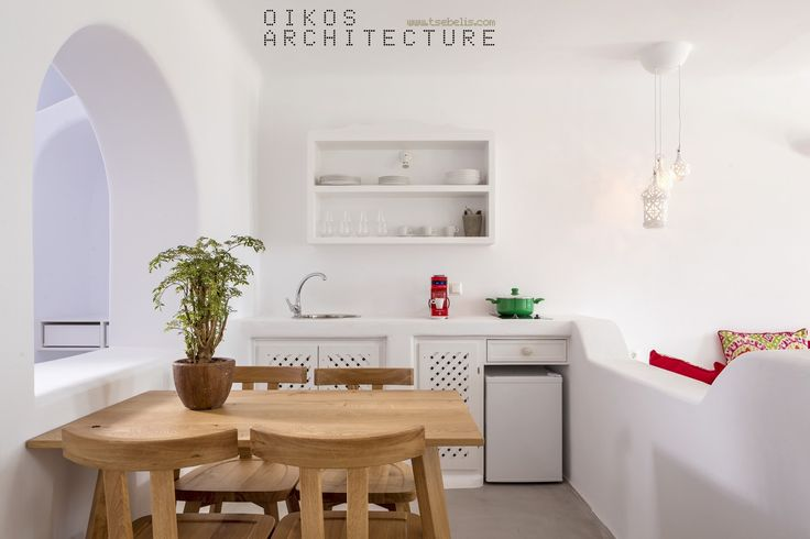 private suites, pyrgos, santorini, skyfall suites, wooden table, kitchen, pure white, natural materials