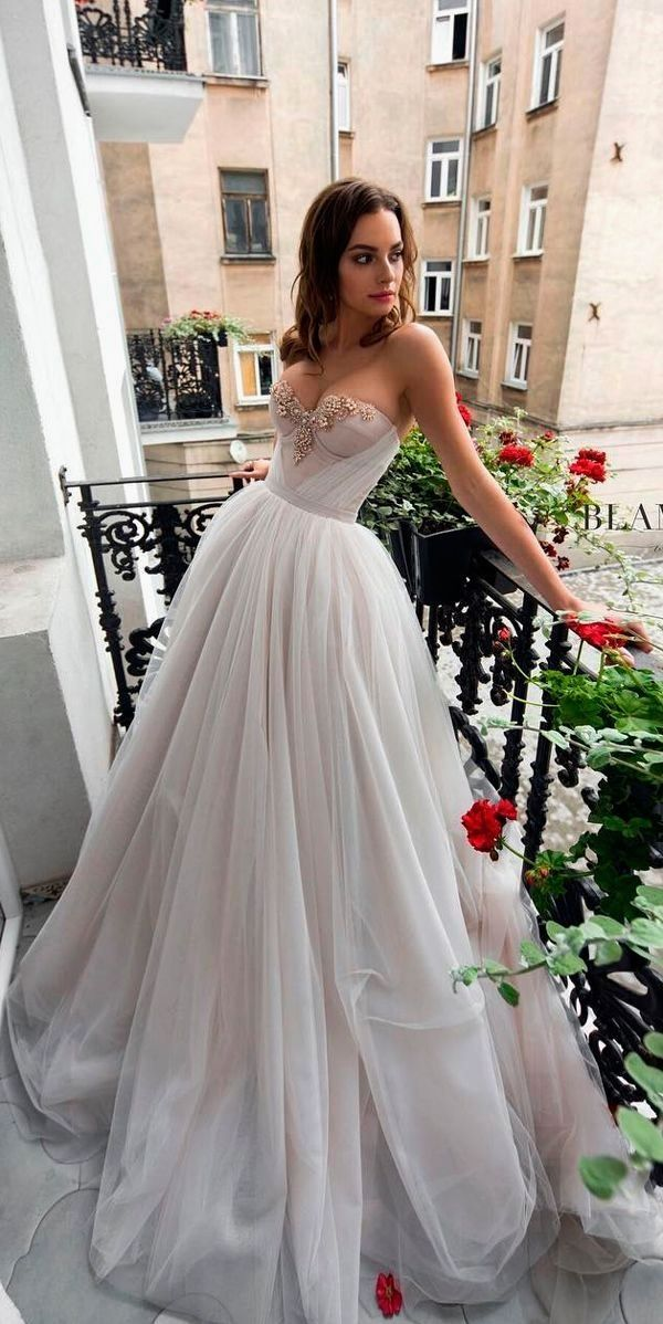 1219e832bdd White wedding dress. Brides want to find themselves finding the ideal  wedding day