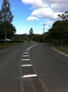 Councils use Rumble Bars, also know as Pavement Bars, to separate traffic on busy suburban streets