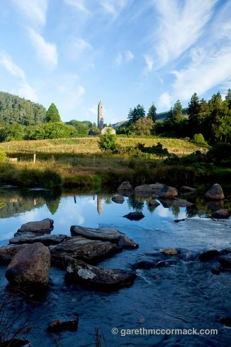 Reflection of Glendalough round tower, Wicklow Mountains National Park, Co Wicklow, Ireland. Stock Photo
