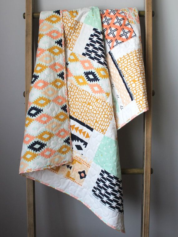 This quilt is completed and ready to ship to you! This gender neutral baby quilt features fabrics from the Arizona collection in a gender neutral
