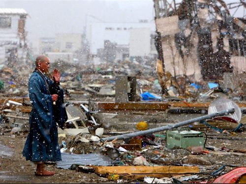 A Buddhist priest prays for the souls of the victims still not found in the rubble, Yamada, Japan. Stunning. Thank you, kateoplis.