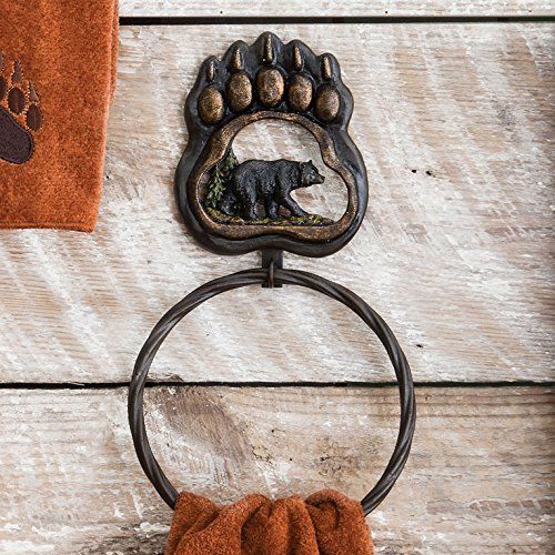 """The twisted steel #Bear Paw #Wilderness Towel Ring is embellished with a polyresin bear scene in a metallic bear track for abundant rustic style. Measures 6??""""W x..."""