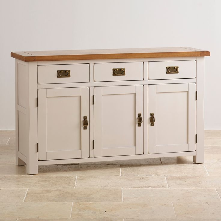 Made from stunning painted acacia and solid oak, this large sideboard creates an elegant country cottage charm in the home. Buy yours online today.
